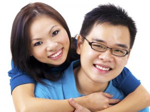 happy couple discover dental